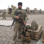 "Staff Sgt. Zachary Cahall, 436th Security Forces Squadron dog handler, poses with his dog ""Iggy"" Dec. 5, 2012, at Shindad Air Base in Western Afghanistan. Cahall was wounded during an incident near his deployed location Dec. 28, 2012. (Courtesy photo)"